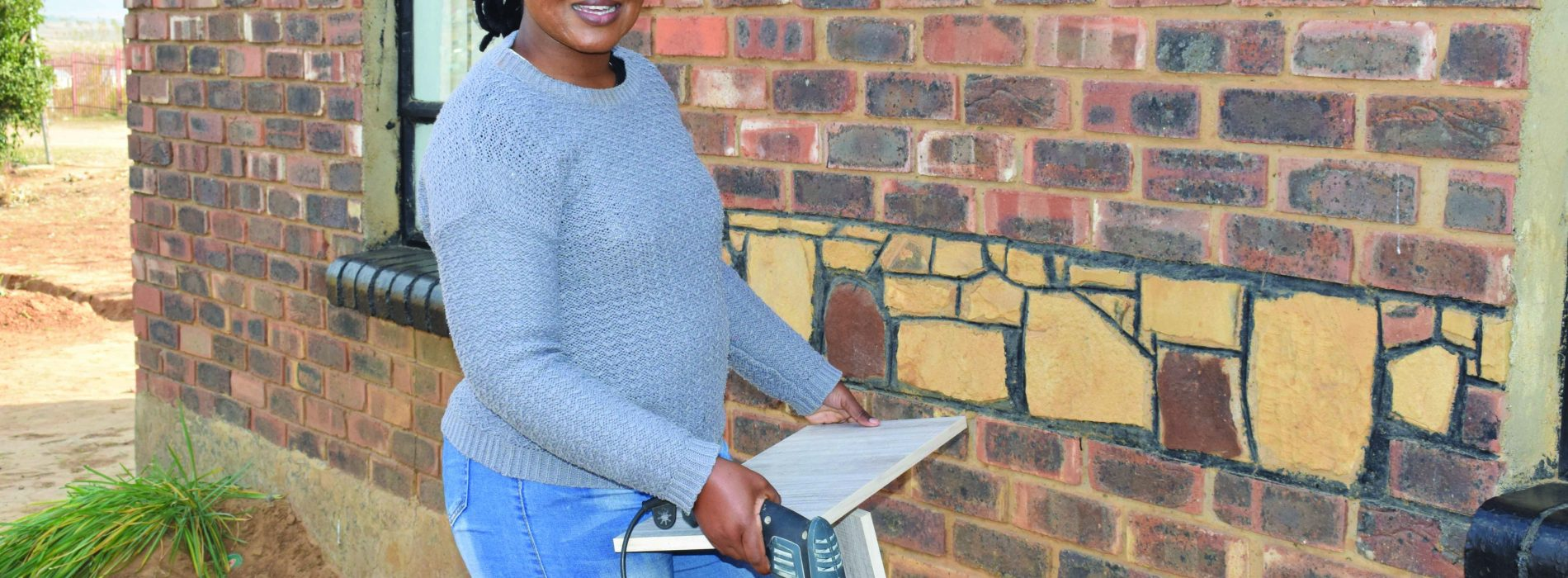 Woman  carpenter drills her way through